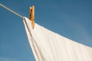 Clothespin on white sheet